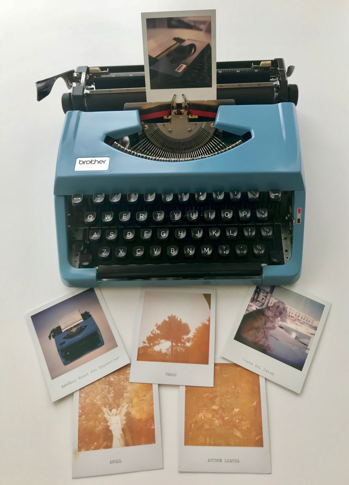 Typewriter and Polaroids